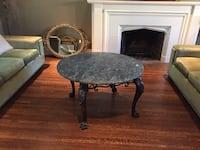 round cast iron table with a shiny finish stone top Toronto, M5N 1W3