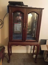 brown wooden framed glass display cabinet Edmonton, T5H 4E7