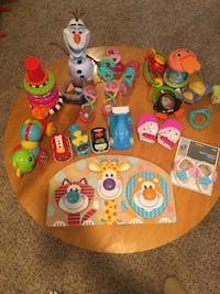 Baby toys, puzzles, cars.