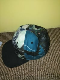 blue, black, and gray flat brimmed cap