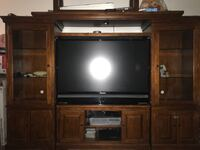 Brown wooden TV hutch with flat screen television Los Angeles, 91406