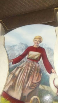 woman with red and beige long-sleeve dress collectible plate