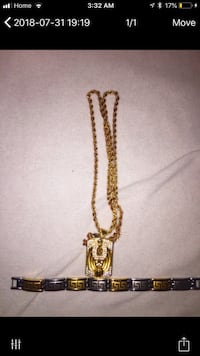gold-colored cross pendant necklace
