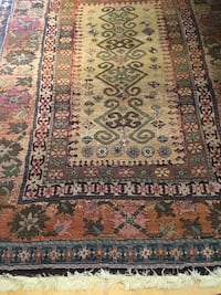 Beige, black, orange, and green floral rug Montgomery Village, 20886