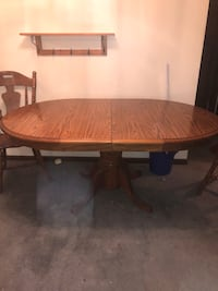 Oval brown wooden dining table Tinley Park