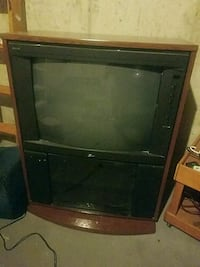 black CRT TV with brown wooden TV hutch Lebanon, 45036