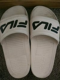 pair of white-and-black Nike slide sandals Des Moines, 50309