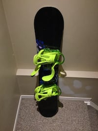 Blue and green snowboard with bindings