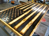 brown and black wooden bed frame Colorado Springs, 80917