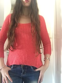 Orange knitted shirt with gold detailing