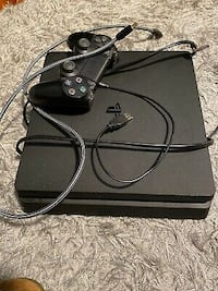 Used PS4 console and a controller