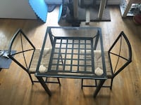 black metal framed glass top table