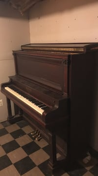 Brown wooden upright piano 25 km