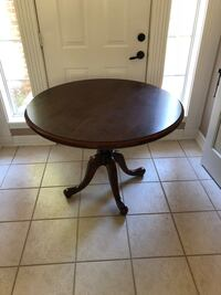 Round brown wooden pedestal table Troup, 75789