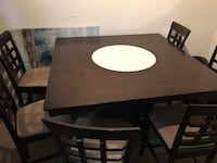 wooden table with 6 chairs dining set glass center spins. Underneath storage. Prices to sell quick  24 km