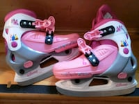 pair of white-and-pink inline skates princess  Laval, H7X 2G3