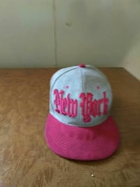 gray and pink New York print cap