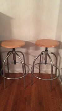 two brown wooden bar stools 24 mi