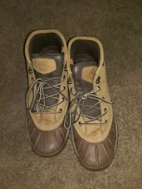 pair of brown-and-black work boots 67 km