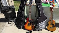 two electric guitars with guitar cases and guitar amplifier Calgary, T2Y 2W7