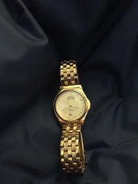 round gold analog watch with gold link bracelet 3731 km