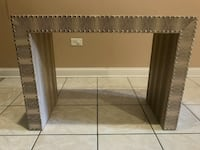 Accent table with nailhead trim around all the edges...