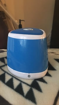 Blue and white portable bluetooth speaker