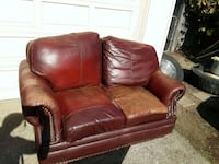 brown leather loveseat with throw pillows Eugene