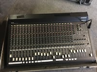Mackie SR24-4 mixing board with hard shell travel case and stand.