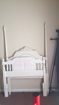 White wooden bed headboard and footboard with railings Fayetteville, 28303