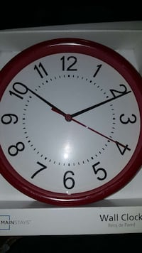 red and white Mainstays wall clock with box 48 km