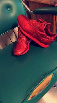 pair of red Reebok Classic shoes