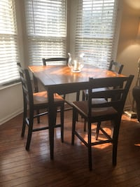rectangular brown wooden table with four chairs dining set Upper Marlboro, 20774