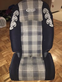 toddler's gray and black Graco car seat