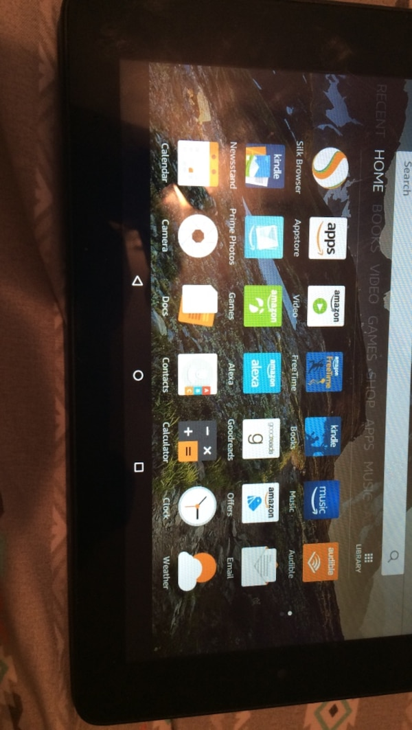 Black amazon fire tablet in excellent condition .