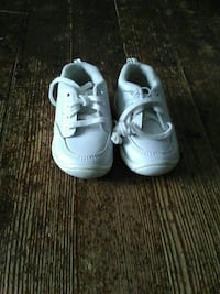 toddler's pair of white low-top sneakers