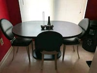 round brown wooden table with four chairs dining set Gaithersburg, 20878
