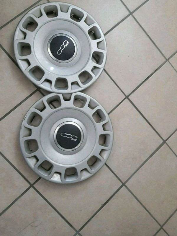 used two grey and black authentic fiat 500 hubcaps for sale in