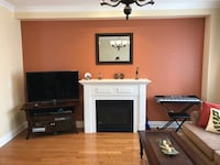 white wooden TV stand with flat screen television Toronto, M8Z 3Z8