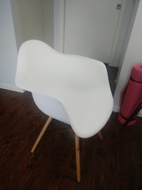 White plastic Chair with wooden legs