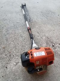 orange, black, and gray long reach hedge trimmer