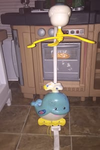 baby cradle music playing toy