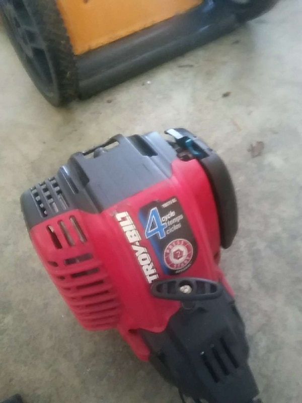 red and black Troy-Bilt gas string trimmer