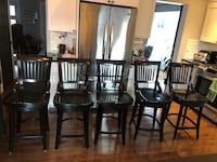 Four brown wooden chairs that swivel. A few edges are chipped, can be fixed by anyone who knows how to work With wood.  Retail for $250 per chair plus tax  Ottawa, K4A 1Z5