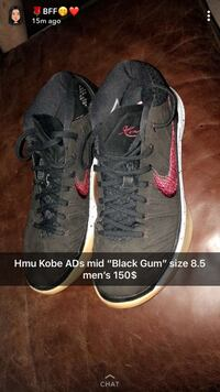 pair of black-and-red Nike sneakers Calgary, T2W 1B4
