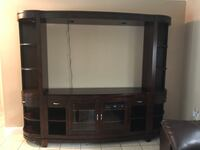 Entertainment Center.  Normal wear, small visible scratch at bottom (photo).  Holds up to 65 inch TV. Sarasota, 34233
