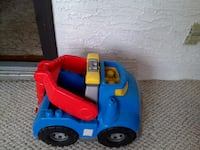 blue, red, and gray plastic ride-on car toy