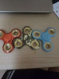 red, camouflage, and blue fidget spinners Winnipeg, R2M