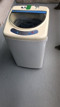 Haired portable washing machine