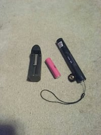 black laser pointer and pink battery